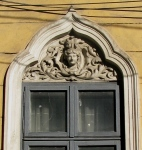Stucco moulding female head & accolade shaped window arch, Bucharest