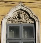 Window with stucco female head, Bucharest