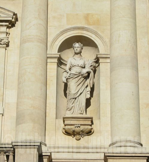 Statue on the facade of the National Bank Palace, Bucharest