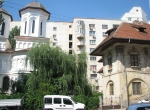 The church and the parish house on the background of 1980s apartmentbuildings
