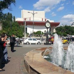 Taking photos during tour, University Square, central Bucharest