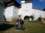 Visitors in front of the fortified church of Viscri,Transylvania