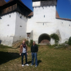 Visitors in front of the fortified church of Viscri, Transylvania