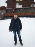Standing on the frozen and snow-covered Balea Lake in midMarch