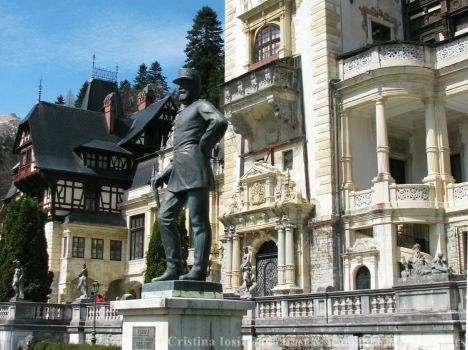 King Carol I statue stands proudly in front of his Peles Castle, Sinaia