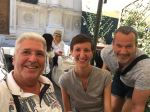 Cheerful travelers during Bucharest citytour