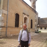 Charming gentleman, guest of my Constanta & Black Sea Coast tour, posing in front of Hunchiar Mosque in Constanta