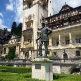 King Carol standing proud in front of his Peles Castle