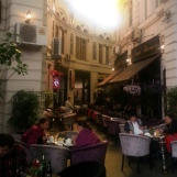 Cafes in glass covered arcaded street, central Bucharest