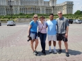 With new friends in front of Palace of Parliament during Bucharest tour