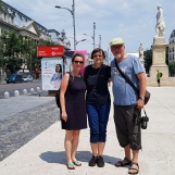 Cris your guide with guests from Germany in central Bucharest during tour, Aug 2019