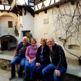Cheerful tourists at Bran Castle, Transylvania, April 2018