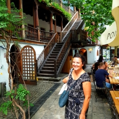 Joyous visitor at Manuc's Inn in Bucharest, during tour, July 2018
